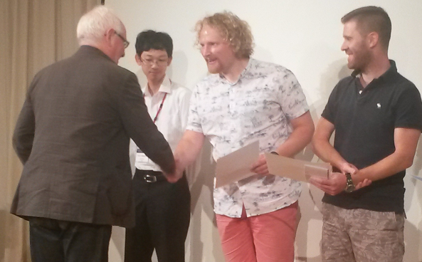 Simon reieves his poster prize at the International Symposium on Free Radicals, Hayama, Japan
