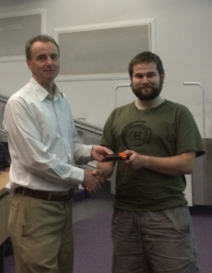Prof Ken McKendrick presented Tom with his Y3 PhD talk prize